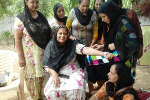 Anganwadi workers protest in defiance outside Sports Minister's residence, offer blood for government