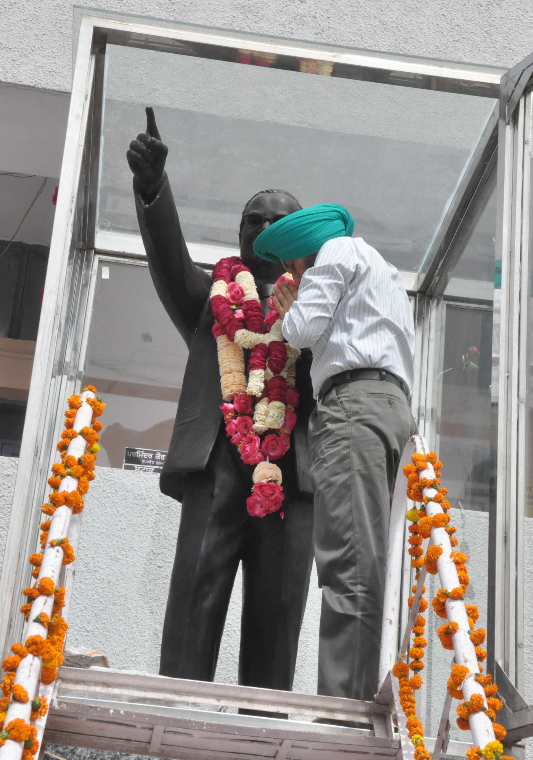 CP AND DC PAY FLORAL TRIBUTES TO DR AMBEDKAR