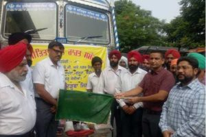 DC flagged off truck and trolleys filled with relief materials to help families affected by floods